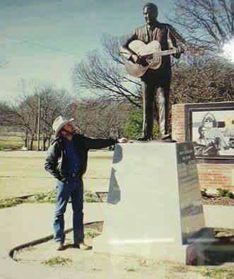 "Merle Haggard considered Lefty Frizzell his inspiration as a singer. Here's Hag at Lefty's memorial statue in Corsicana, Texas. Merle once informed me, ""If I ever had a 'singing idol', it would be Lefty. However, I don't believe in idols ... but I do believe Lefty was the best country singer I ever heard."" Photo by Bill Mack"