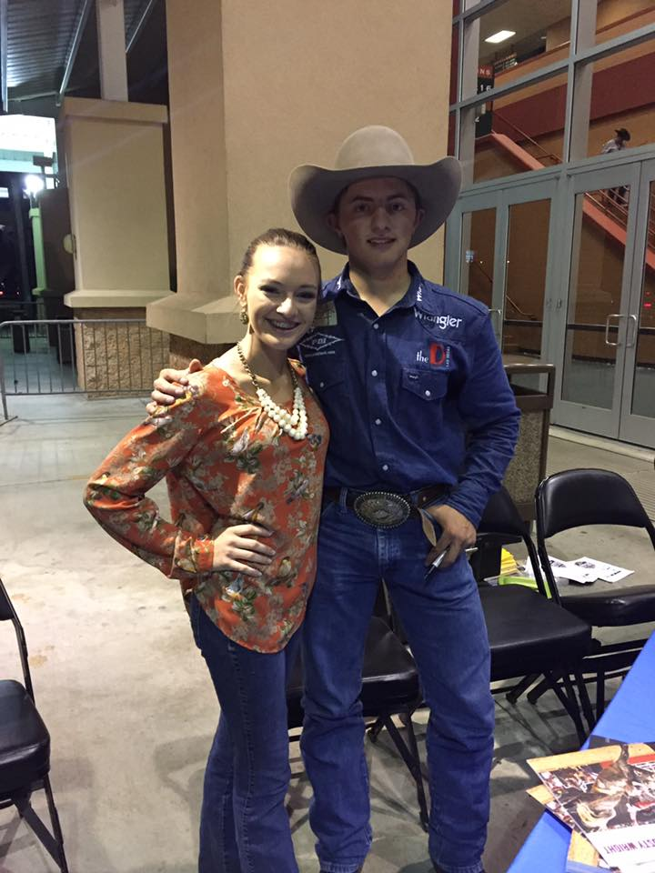 PRCA Saddle bronc rider, Rusty Wright, riding for team Wrangler tonight in Experience Kissimmee, Florida at the #WranglerChampionsChallenge takes time to pose for a fan pic during the meet-n-greet at the rodeo tonight!