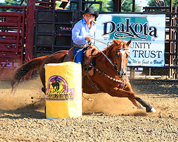 Jana Griemsman's time of 14.75 seconds leads more than 100 barrel racers at Mandan Rodeo Days. Photo by Jackie Jensen