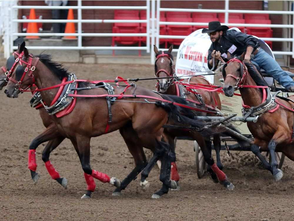 Chance Bensmiller and the Western RV/Country 105 wagon rounds the barrels in heat 2 of the GMC Rangeland Derby at the Calgary Stampede on July 12, 2016.GAVIN YOUNG/CALGARY HERALD