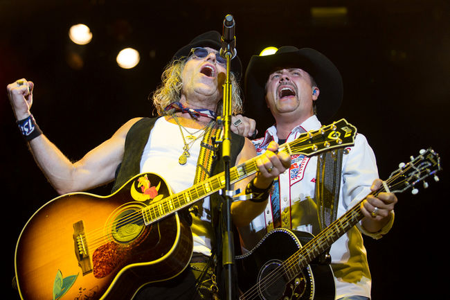 Big & Rich perform at the Texas Thunder Country Music Festival, Saturday, Aug. 22, 2015, in Gardendale Texas. (Courtney Sacco/Odessa American via AP) MANDATORY CREDIT