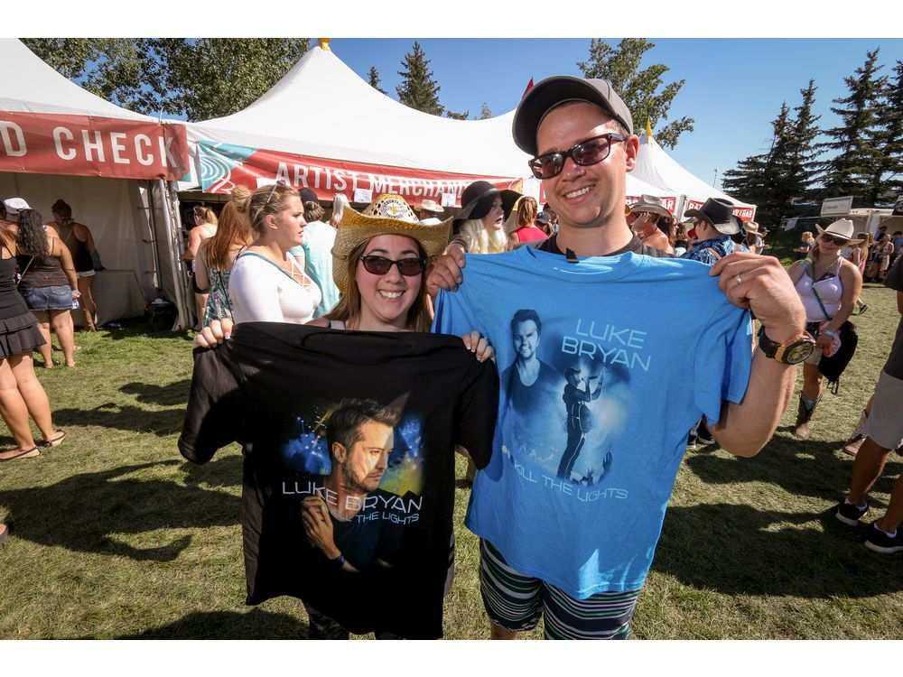 Kayla and Gerard Rice came all the way from Goose Bay, Labrador to see Luke Bryan perform at day 3 of Country Thunder at Prairie Winds Park in Calgary. MIKE DREW /  MIKE DREW/POSTMEDIA