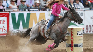 Barrel racer Nellie Miller, of Cottonwood, Calif., tops the scoreboard for the day with a 17.42 second run during the Ellensburg Rodeo, Sunday, Sept. 4, 2016. (Brian Myrick / Daily Record)