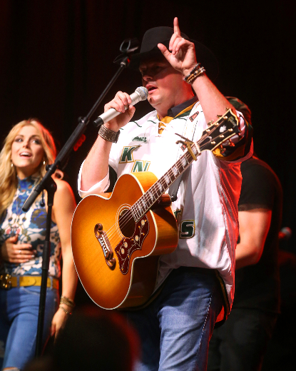 Gord Bamford performs his hit Is it Friday Yet at the outdoor stage on Talbot Street as part of the CCMA festivities on Friday night. (MIKE HENSEN, The London Free Press)