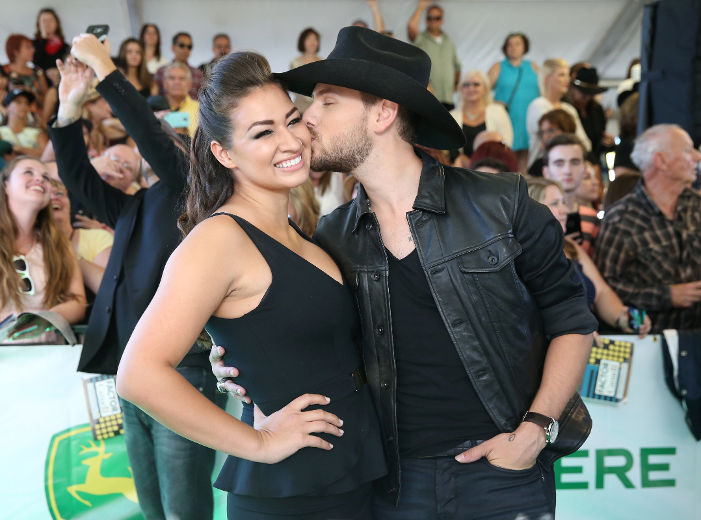 Brett Kissel kisses his wife Cecilia on the green carpet as country artists arrive for the Canadian Country Music Awards at Budweiser Gardens in London, Ont. on Sunday September 11, 2016. Craig Glover/The London Free Press/Postmedia Network