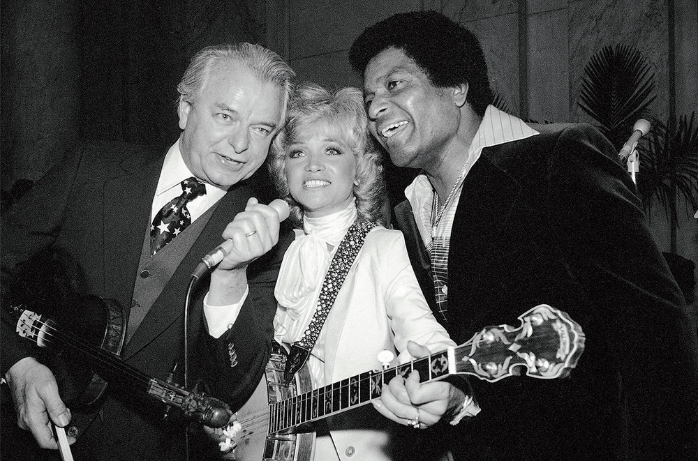 AP Photo/Charles Harrity Senate Majority Leader Robert Byrd of West Virginia is joined by Barbara Mandrell and Charley Pride as he entertains at a Country Music Association reception for members of Congress on April 23, 1980 in Washington.