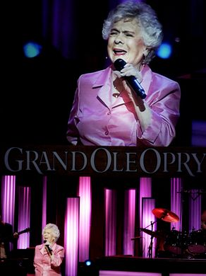 """Jean Shepard performs for a packed audience during the """"Grand Ole Opry"""" show on the stage of the Ryman Auditorium on July 21, 1973.Photo by Jeanne Reasonover/The Tennessean"""