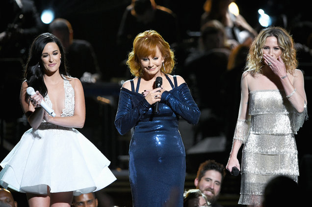 Kacey Musgraves, Reba McEntire and Jennifer Nettles perform for Dolly Parton onstage at the 50th annual CMA Awards at the Bridgestone Arena on Nov. 2, 2016 in Nashville, Tenn.