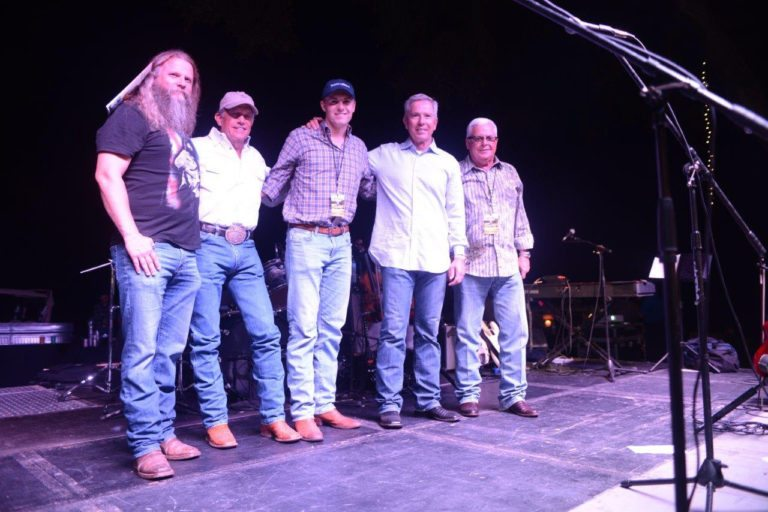 Jamey Johnson and George Strait played a concert during the benefit.