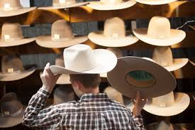 Chase Webster, 13, tries on a hat at the Cowboy Christmas gift show in the south halls of the Las Vegas Convention Center on Sunday, Dec. 4, 2016, in Las Vegas. (Rachel Aston/Las Vegas Review-Journal)