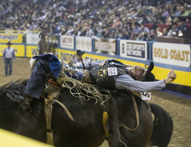 Orin Larsen rides Full Baggage during the bareback riding competition at the National Finals Rodeo at the Thomas & Mack Center on Thursday, Dec. 8, 2016, in Las Vegas. Benjamin Hager/Las Vegas Review-Journal