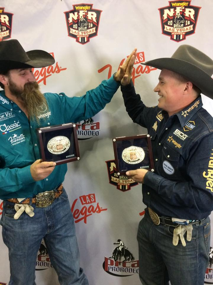 An elated and emotional Levi Simpson (r) & Jeremy Buhler after winning the 2016 Team Roping World Championship - Covy Moore photo