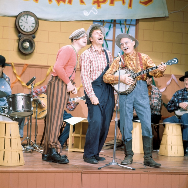 Hee Haw ran until 1993, featuring Gordie Tapp, centre, as Cousin Clem, and was the longest running country variety show in U.S. television history. (CBC Still Photo Collection)