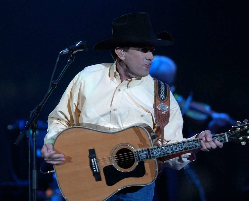 George Strait performs during the last Rodeo concert at the Astrodome, Sunday night, March 3, 2002.