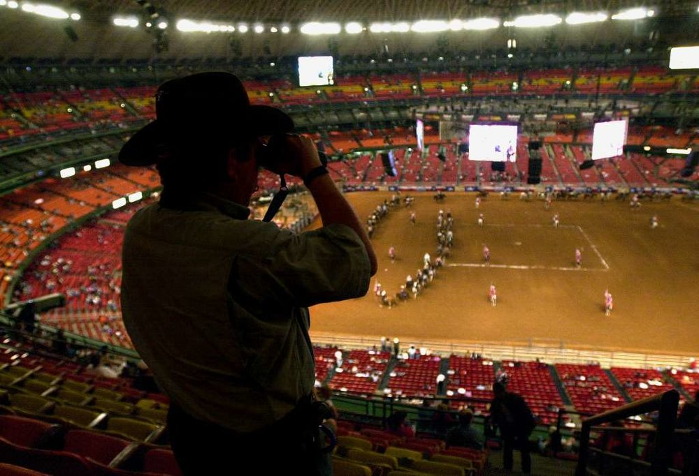 Sam Thompson gets a closer view of the grand entry with his binnoculars while at the Houston Livestock Show and Rodeo, Thursday, February 21, 2002 at the Reliant Astrodome.