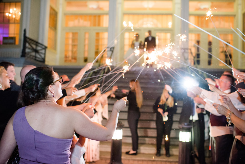 Setting up a sparkler send-off: safety first! Image by Meghan Rose Photography
