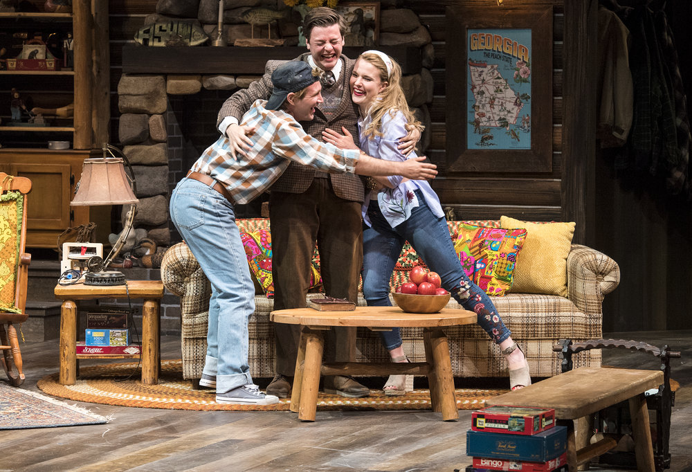 Rob Riordan (left) as Ellard Simms, Michael Doherty as Charlie Baker,  and Katie Fay Francis as Catherine Simms inthe Utah Shakespeare  Festival's 2018 production of The Foreigner.  (Photo by Karl Hugh. Copyright Utah Shakespeare Festival 2018.)
