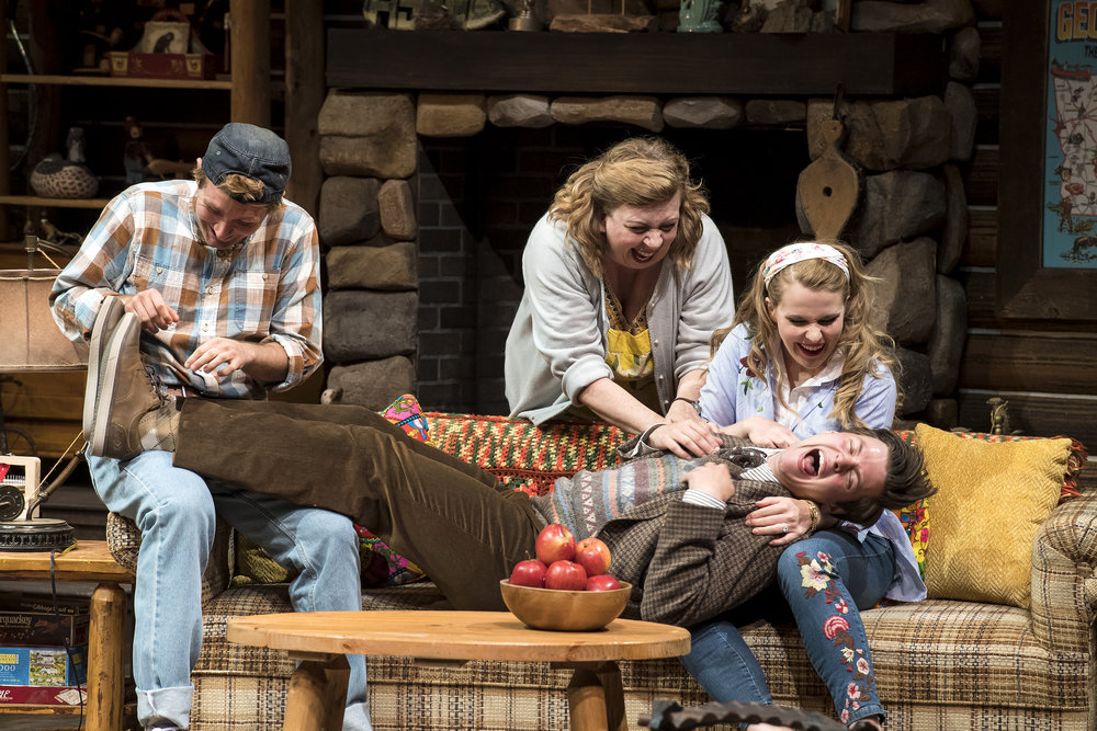 Rob Riordan (left) as Ellard Simms, Colleen Baum as Betty Meeks, Katie  Fay Francis as Catherine Simms, and Michael Doherty as Charlie Baker  inthe Utah Shakespeare Festival's 2018 production of  The Foreigner.  (Photo by Karl Hugh. Copyright Utah Shakespeare Festival 2018.)