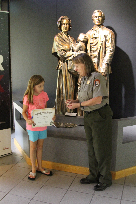 Petunia being certified a Jr. Ranger!