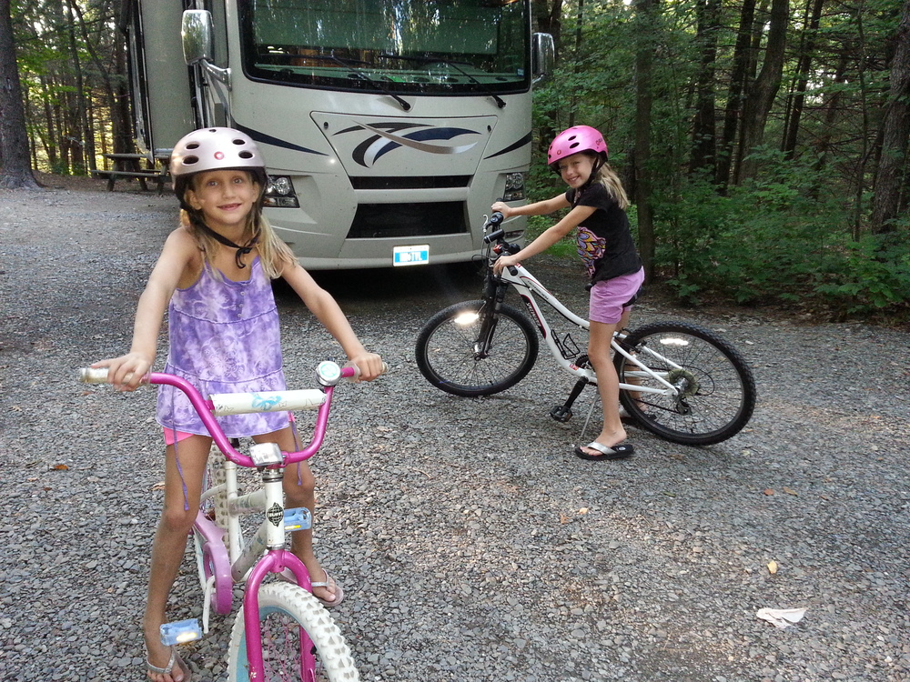 "The sweetest girls with ""almost matching"" bike helmets."
