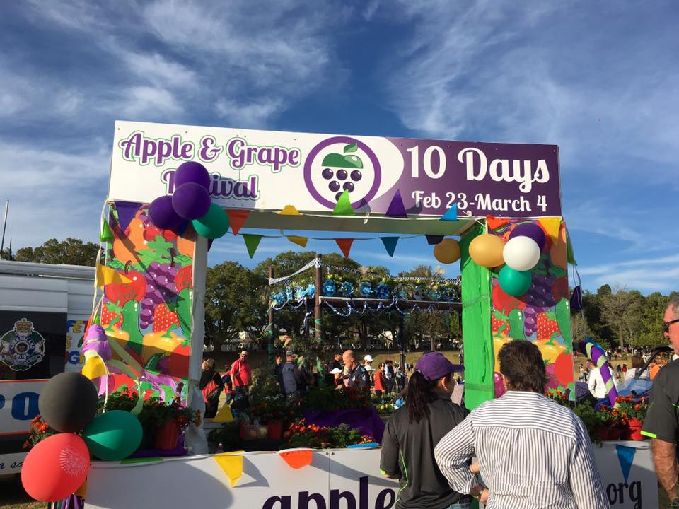 The Apple & Grape float at the Carnival of Flowers. Photo by Charlotte Bush.