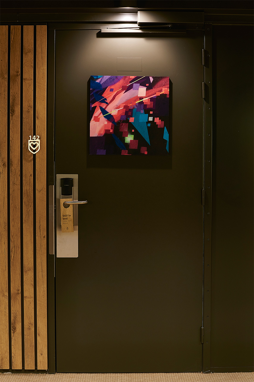 Doors  / The artwork secretly shows housekeeping which room type it is and the rooms numbers are custom-made from stainless steel. One of our favorite details are the laser etched oak door hangers. The corridors are black to create a quite atmosphere with gallery-like splashes of art. When you enter the transition from dark to light makes the small rooms feel more spacious.