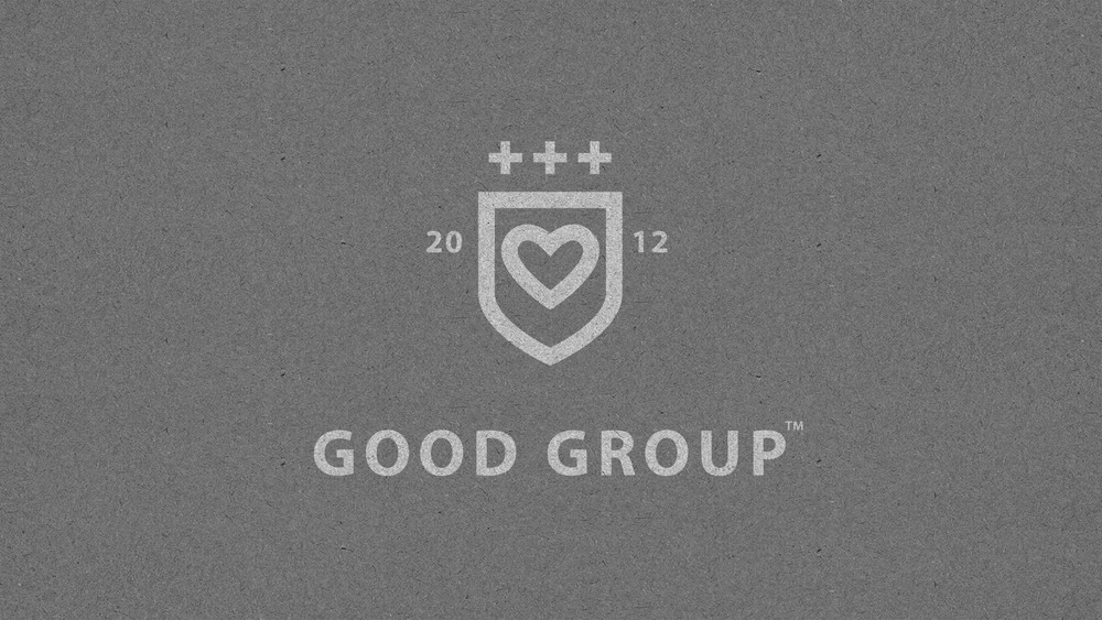 Good Group / Logo with three 'Plus' signs to symbolize the combination of quality, business and doing good.