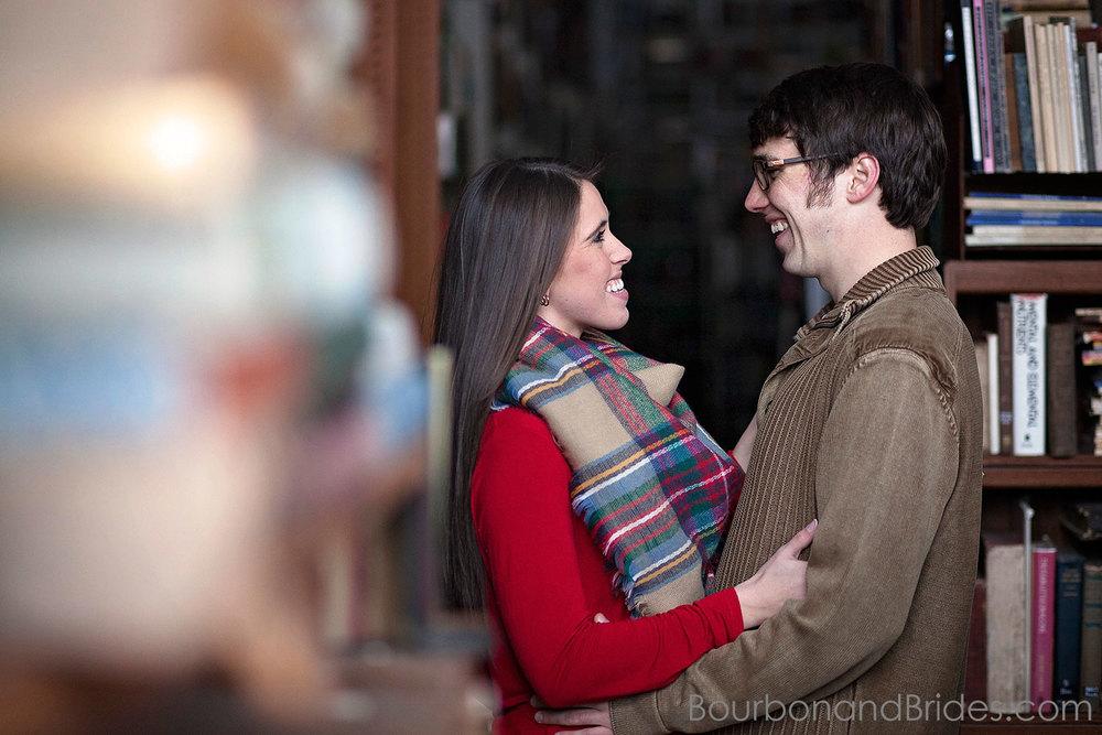 Couple laughing engagement bookstore | Kentucky Wedding Photographers | Bourbon & Brides Kentucky Wedding Photography