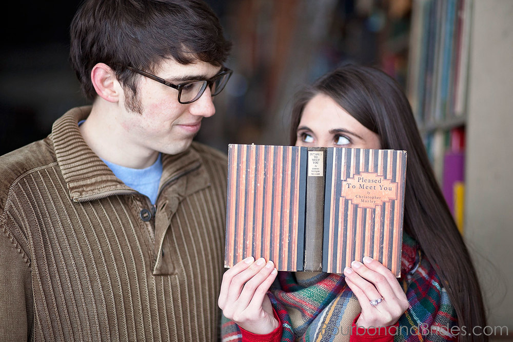 Funny engagement photos in bookstore | Kentucky Wedding Photographers | Bourbon & Brides Kentucky Wedding Photography
