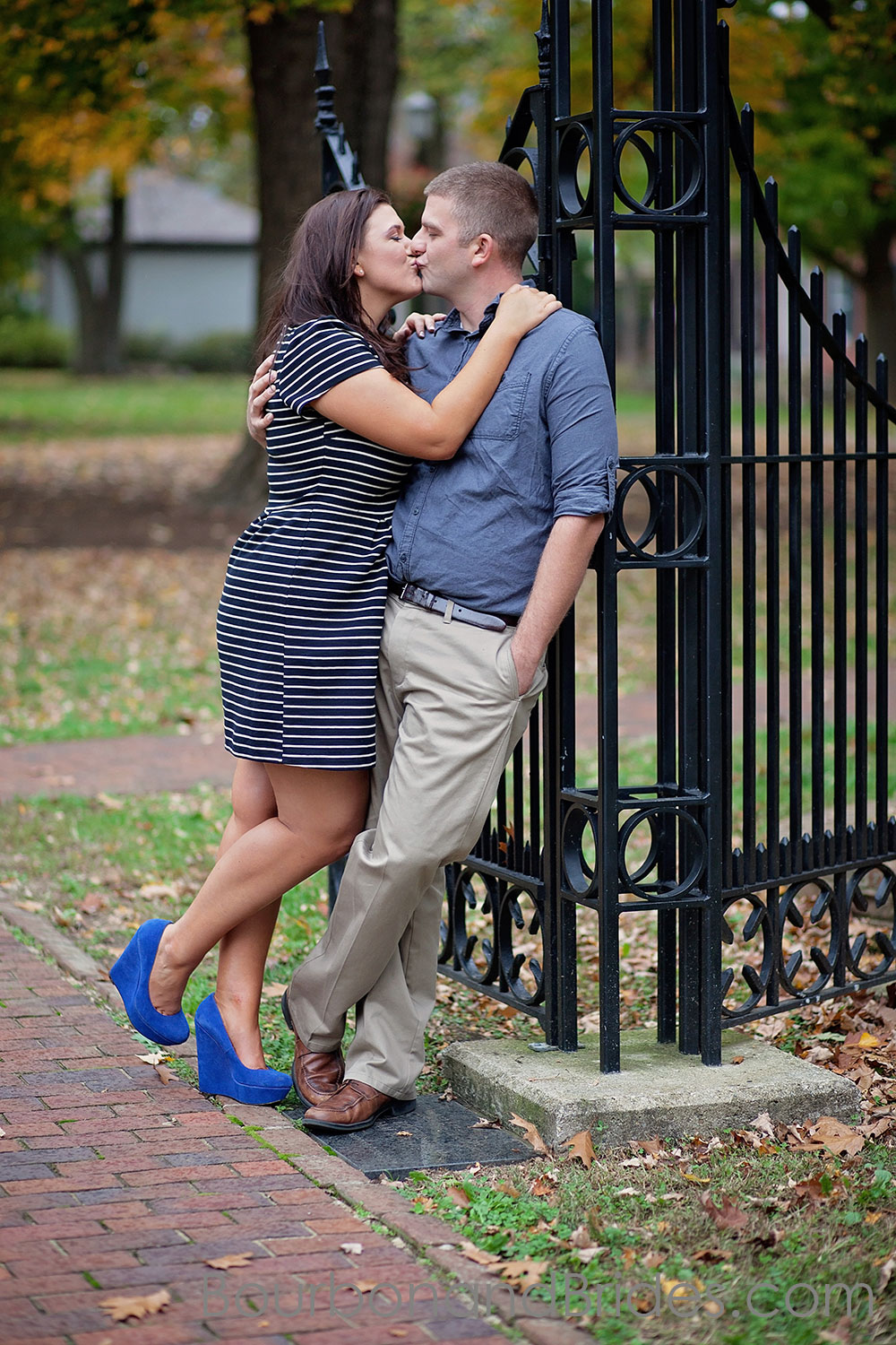 Leaning against gate in Gratz Park Kentucky Engagement Photos| Kentucky Wedding Photographers | Bourbon & Brides Kentucky Wedding Photography