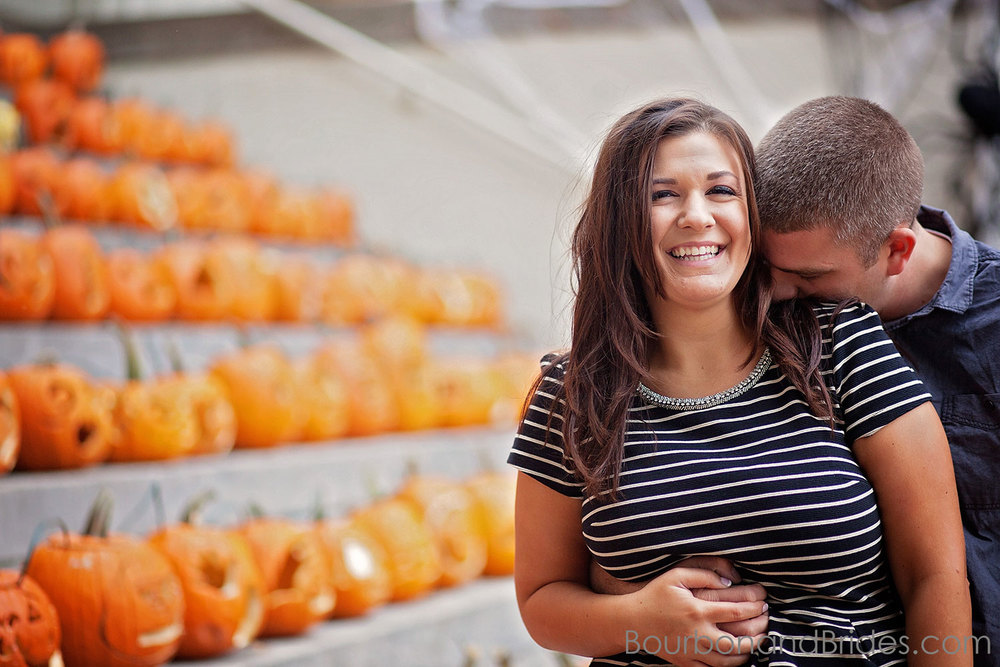 Halloween Pumpkins Leaning against gate in Gratz Park Kentucky Engagement Photos| Kentucky Wedding Photographers | Bourbon & Brides Kentucky Wedding Photography