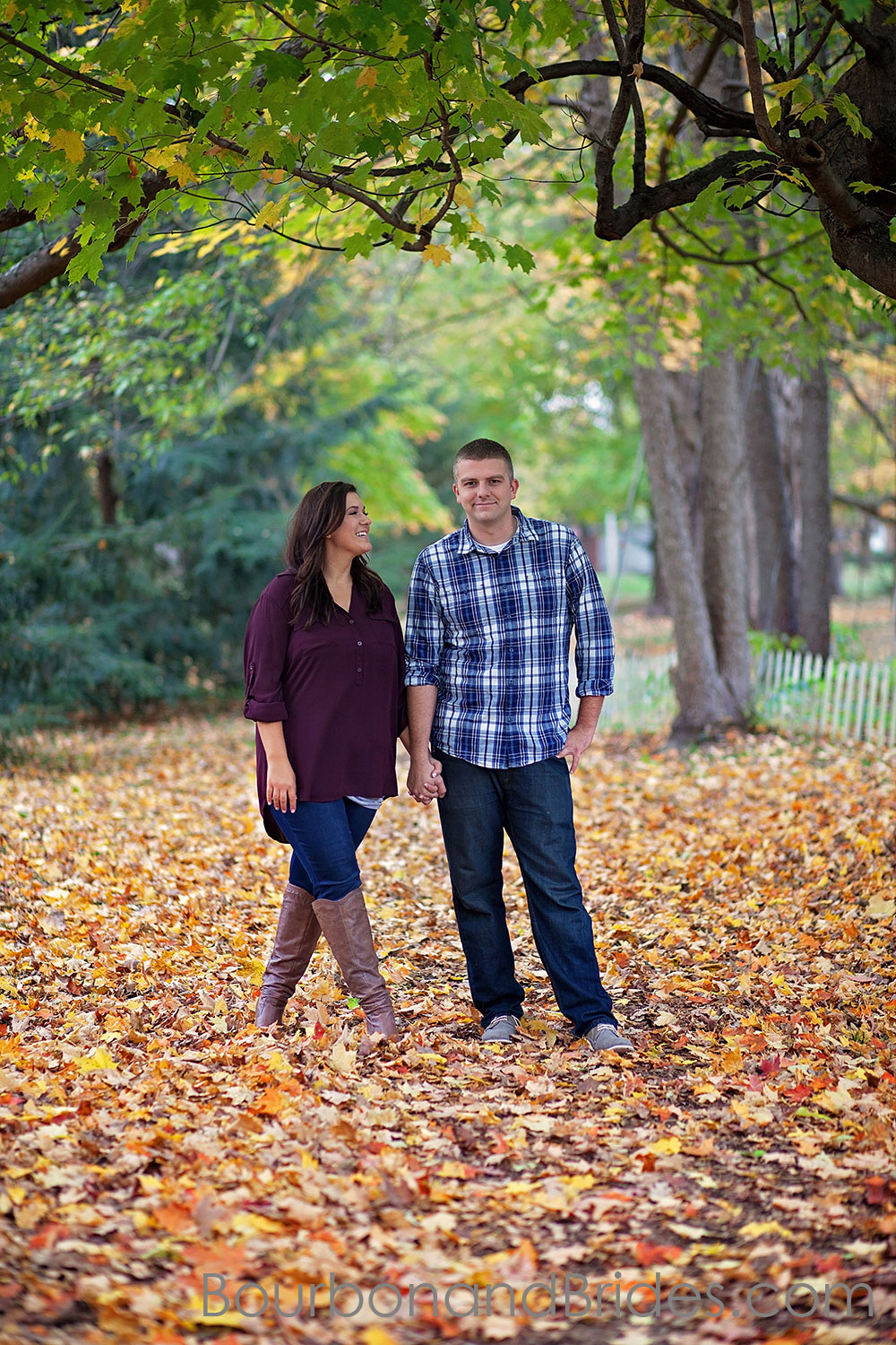 Couple among fall leaves Engagement photos in Ashland | Kentucky engagement photographers | Kentucky Wedding Photogaphers | Bourbon & Brides Kentucky Wedding Photography