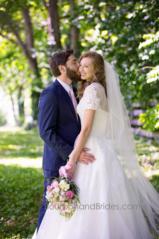 Bride and Groom kissing Portraits   Walnut Hill Church   Kentucky Wedding Photographer   Bourbon & Brides Kentucky Wedding Photography