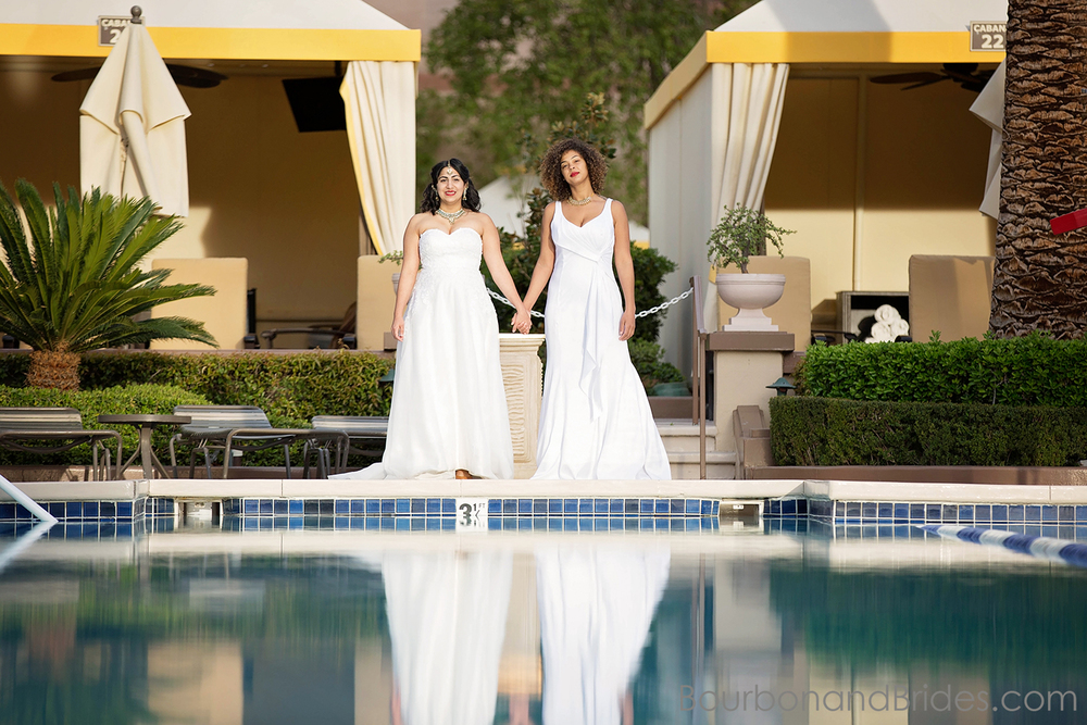 Wedding Couple by pool reflection   Lesbian couple LGBT Wedding Gay Wedding   Las Vegas MGM Grand Wedding   Kentucky Wedding Photographer   Bourbon & Brides Kentucky Wedding Photography