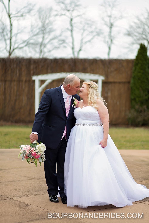 bride-groom-kissing-barrel-house-wedding.jpg
