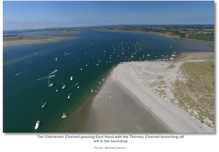 the_chichester_channel_passing_east_head_with_the_thorney_channel_branching_off_left_in_the_backdrop.jpg