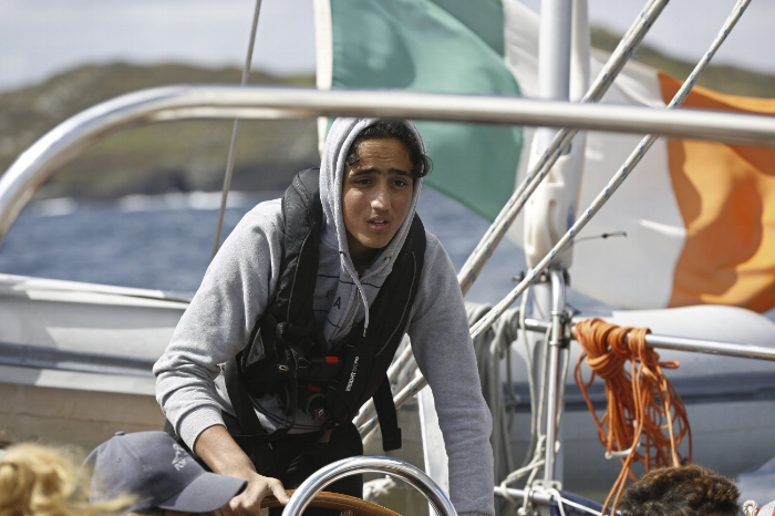A Syrian refugee, resettled to Ireland, takes the helm © Phil Behan for UNHCR, 2017