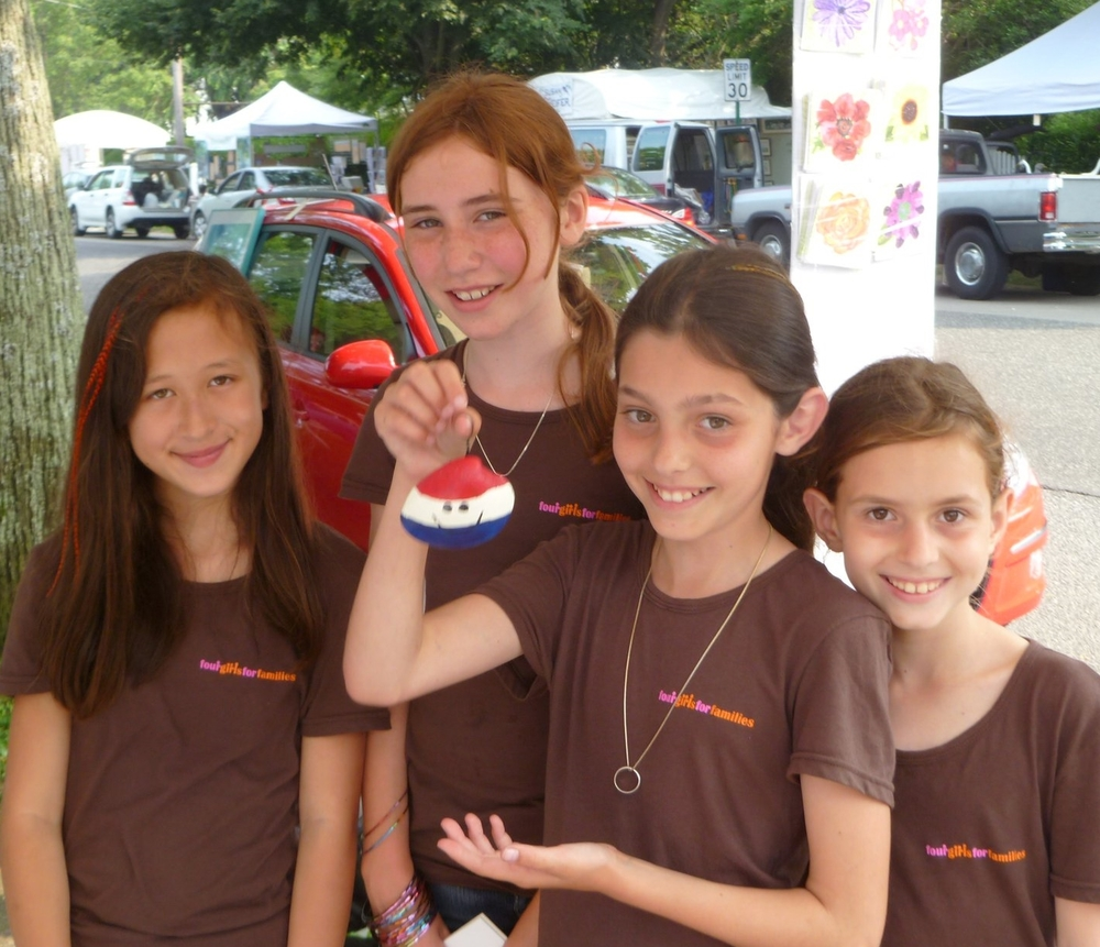The four girls showing an ornament they made for sale (from left): Clara Walker, Maddie Joinnides, Rae Specht and Emmy Specht
