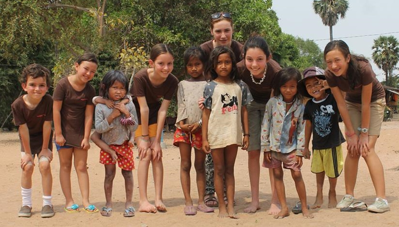 The four girls with Cambodian children