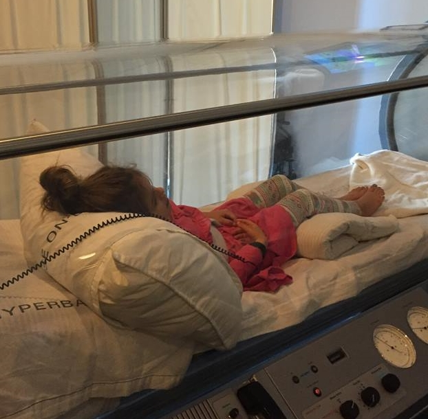 Charlotte receiving hyberbaric therapy