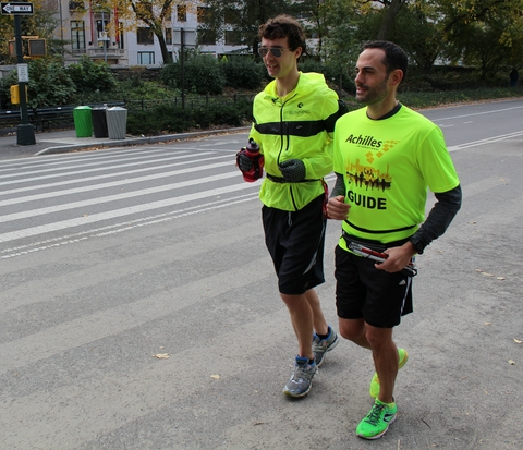 Catherine, left, runs alongside his guide.