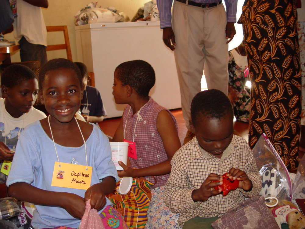Children enjoying their new care bags
