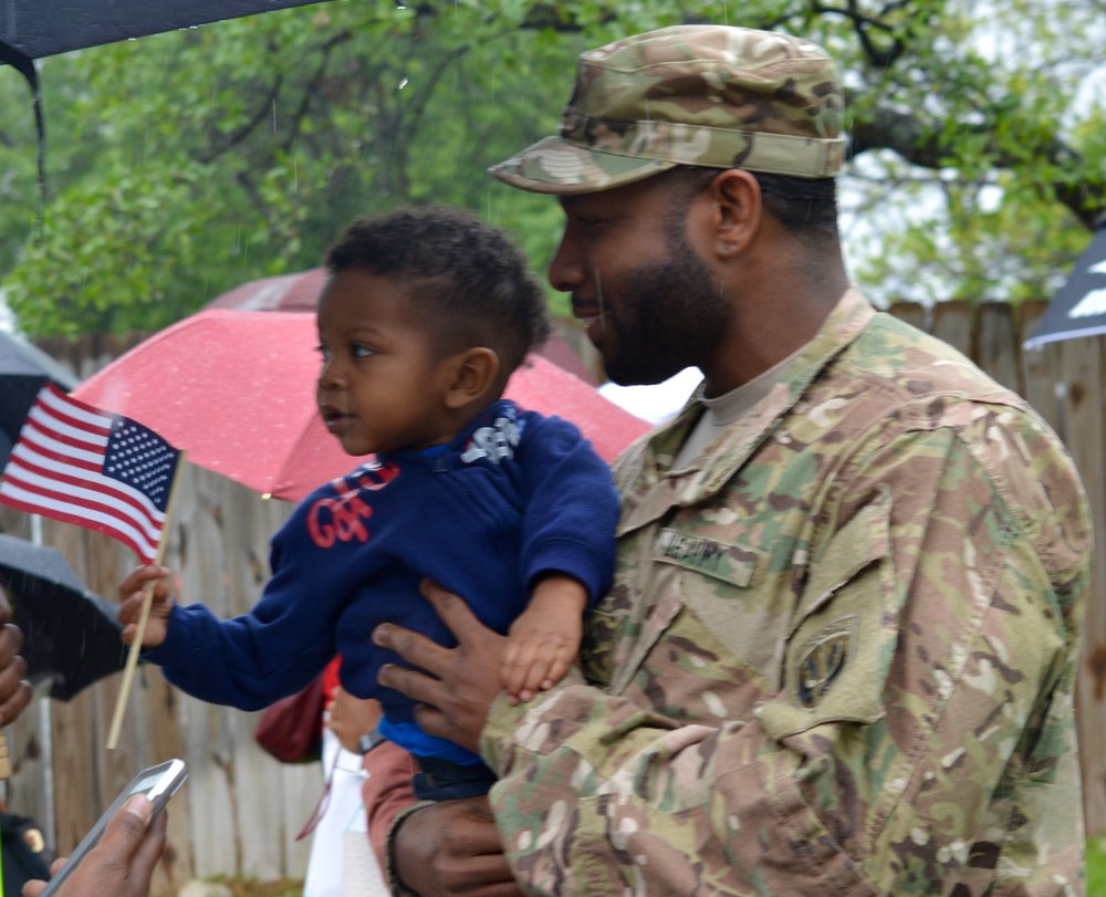 Staff Sgt. Guidry with a small supporter