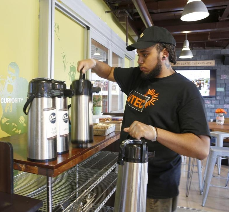Jamel working at Café UTEC (photo credit: Mary Schwalm for The Boston Globe)