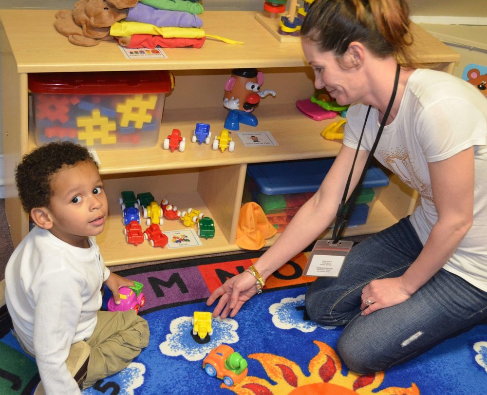 A volunteer helping in a playspace.