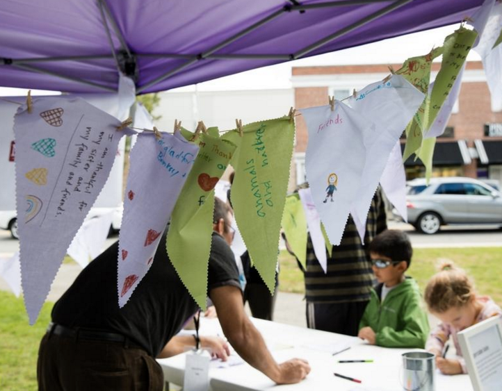 Family flags of gratitude at the family event (photo credit: Caitrin Dunphy)