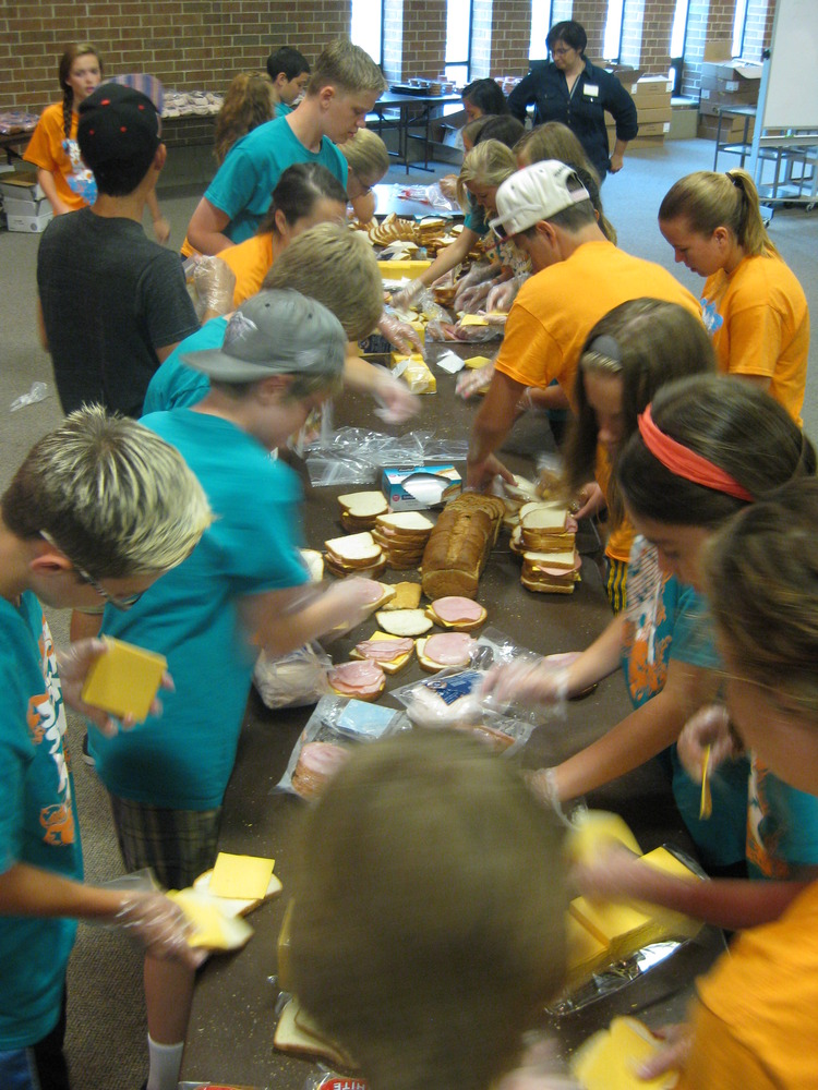 Local volunteers help make over 5,000 sandwiches for Law to deliver.  (photo credit: St. Joseph Catholic Church)