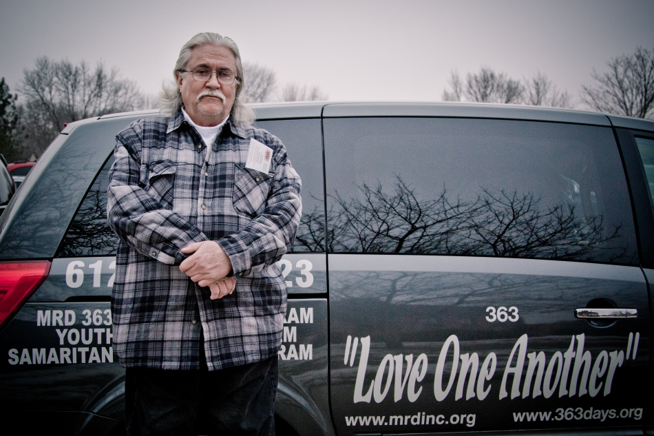 Allan Law with the Love One Another delivery van.