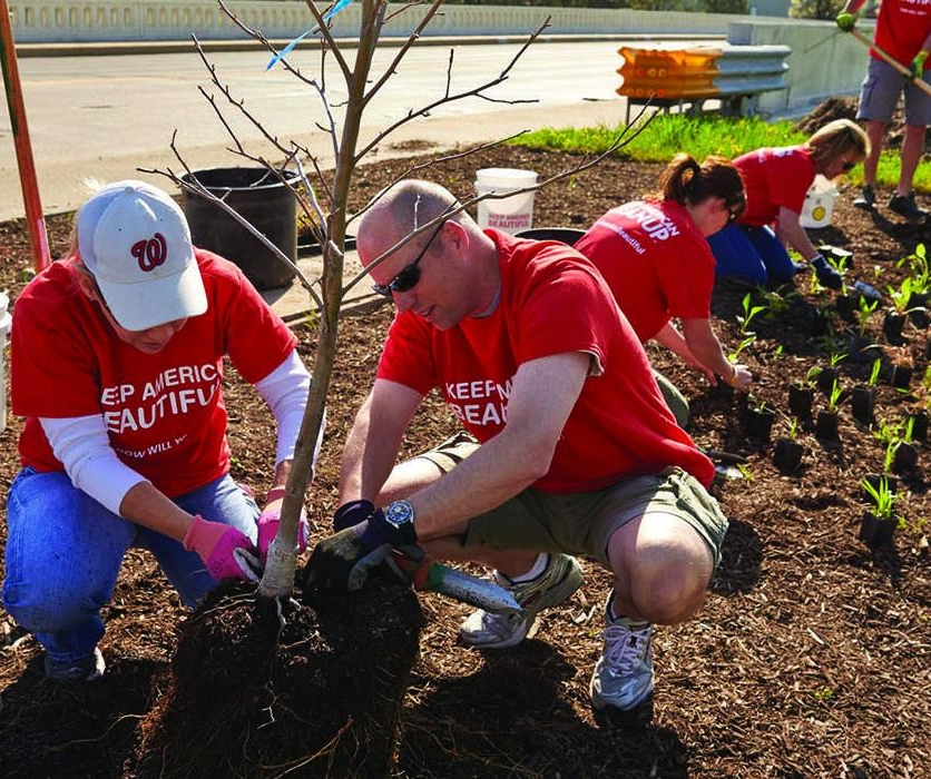 Volunteers plant trees at a Keep America Beautiful event
