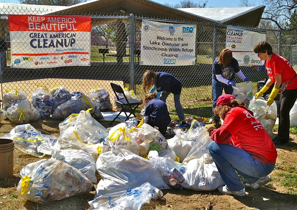 Volunteers sort recycling at a Cleanup event